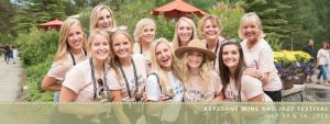 a bachelorette party poses with their wine glasses at wine and jazz festival