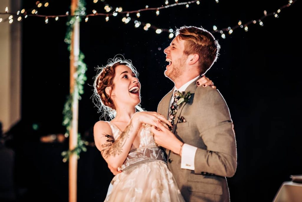Wedding Couple Laughing at Reception
