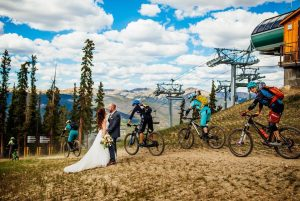 Couple Kissing on Top of Dercum Mountain, Mountain Bikers going Past