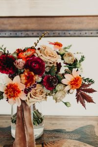 Brides Bouquet in Vase on Wood Table
