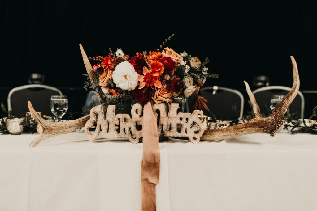 Head Table Decorated with Mr. and Mrs. Sign