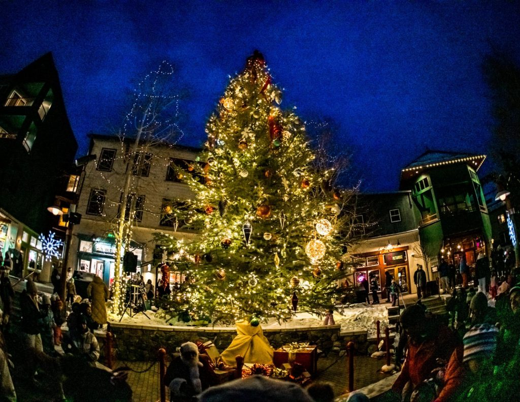 The River Run Holiday Tree lights up the village as onlookers celebrate the holiday season