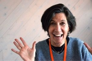 comedian Nancy Norton faces the camera with expressive hands