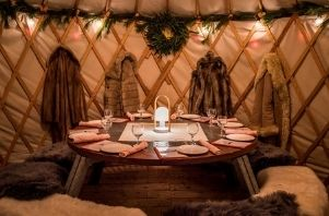 the inside of a yurt for outdoor indoor dining at Aurum Food and Wine Yurt Dining in Breckenridge