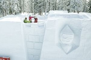 kids play in a giant snow fort