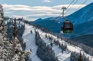 a gondola travels from Dercum Mountain to North Peak at Keystone