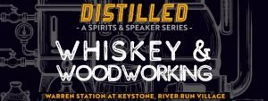 """""""whiskey and woodworking"""" text over black barrel background"""