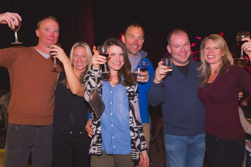 6 friends raise their wine glasses at Keystone's Winter Wine & Spirits Tasting