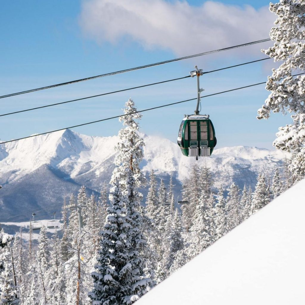Engagement location on the Keystone Outpost Gondola with beautiful mountain views in the background
