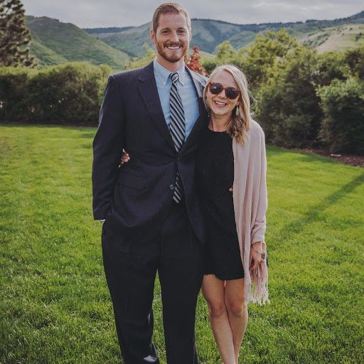 chelsea and brett dressed up at an outdoor wedding